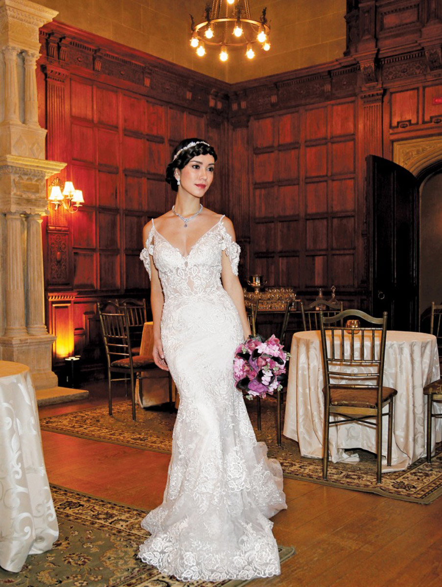 bride in wedding dress in ornate ballroom
