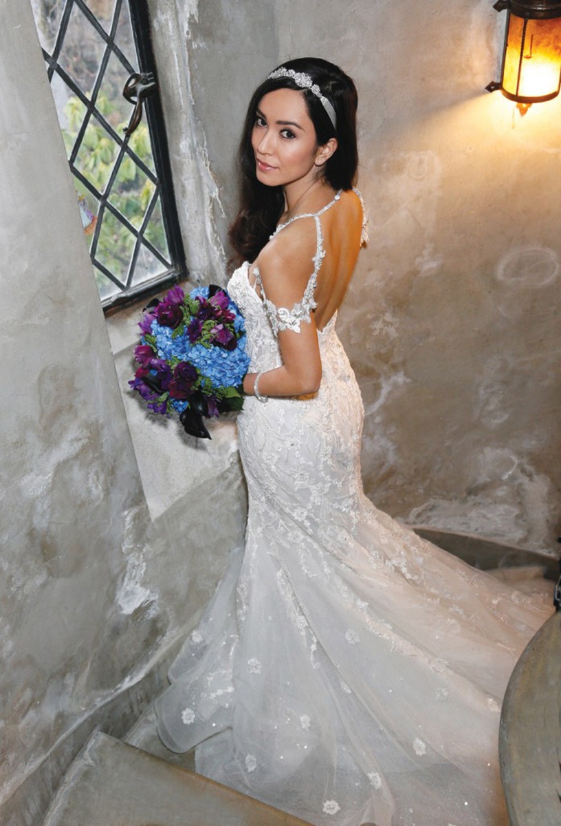 bride in wedding dress in spiral staircase