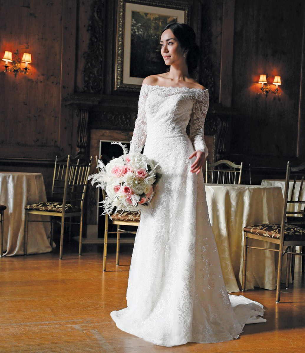 bride in white with flowers in ballroom lace grandiose