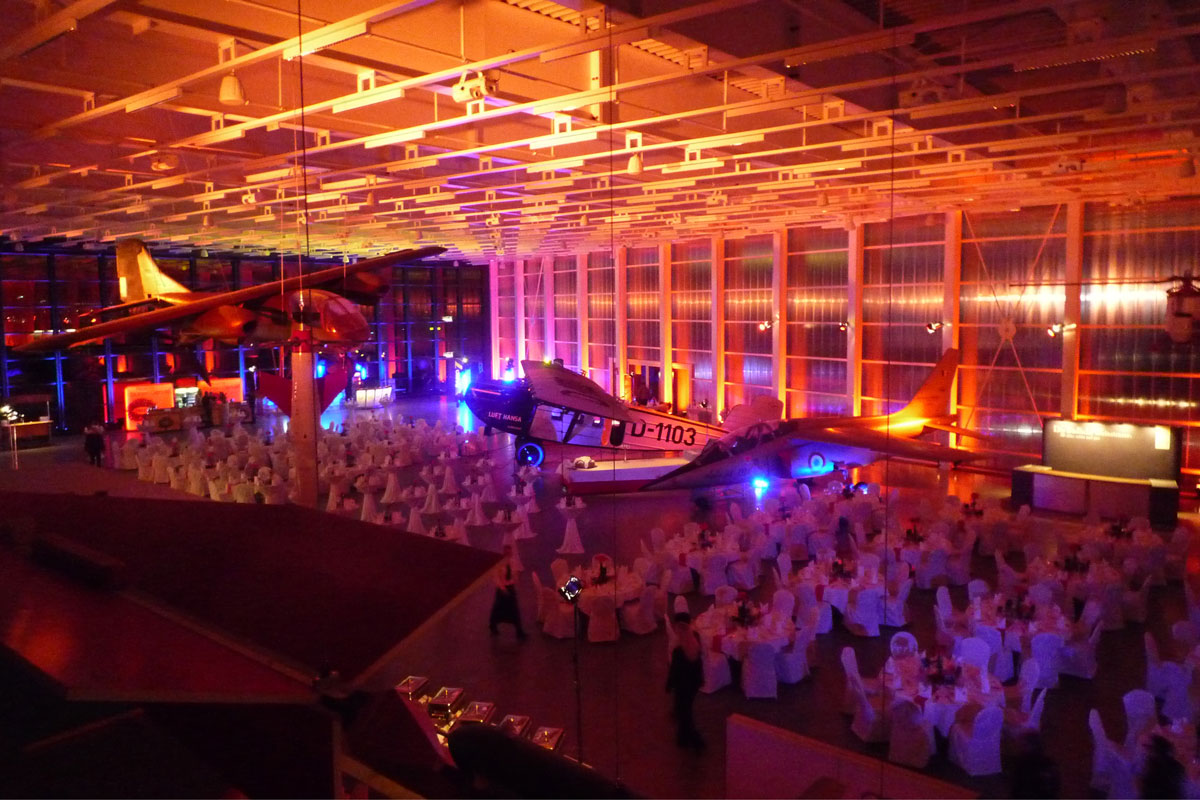 large unique airport event venue dramatic lighting with planes