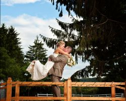 010-bride-groom-embrace-on-bridge-over-brook