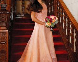 61-bridesmaid-with-flowers-on-red-staircase-wood-bannister