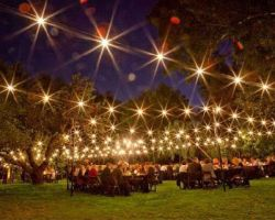 Frungillo-Off-Premise-tent-bistro-string-lighting-catering-reception-table-set-evening-wedding
