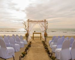beach-wedding-arch-setup-at-sunset