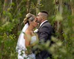 bride-and-groom-kissing-in-forest-wood-venue