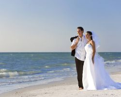 bride-groom-on-beach-looking-out-to-ocean
