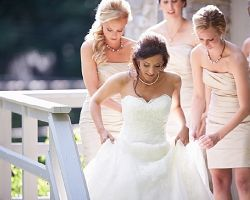 bride-walking-down-stairs-with-bridal-party
