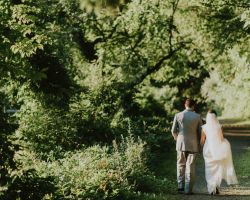 new-jersey-bride-walking-with-groom-in-forest