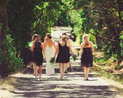 nj-bride-bridesmaids-walking-along-road-to-ceremony
