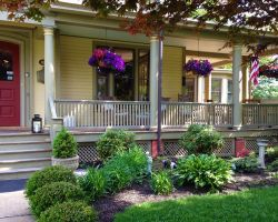 the-debary-inn-exterior-wedding-flowers-sitting-porch-victorian